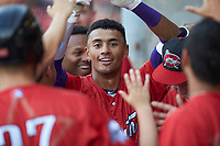 Joel Booker (2) of the Winston-Salem Dash returns to the dugout after hitting a solo home run to lead off the bottom of the first inning during the 2018 Carolina League All-Star Classic at Five County Stadium on June 19, 2018 in Zebulon, North Carolina. The South All-Stars defeated the North All-Stars 7-6.  (Brian Westerholt/Four Seam Images)