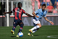 Musa Barrow of Bologna FC and Francesco Acerbi of SS Lazio compete for the ball during the Serie A football match between Bologna FC and SS Lazio at Renato Dall'Ara stadium in Bologna (Italy), October 3rd, 2021. Photo Andrea Staccioli / Insidefoto