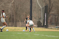 LOUISVILLE, KY - MARCH 13: Savannah McCaskill #7 of Racing Louisville FC tries to move the ball past Julianne Vallerand #26 of West Virginia University during a game between West Virginia University and Racing Louisville FC at Thurman Hutchins Park on March 13, 2021 in Louisville, Kentucky.