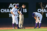Winston-Salem Dash manager Joe McEwing #11 and trainer Josh Fallin check on left fielder Tyler Kuhn #4 after he turned his right ankle at Wake Forest Baseball Stadium August 29, 2009 in Winston-Salem, North Carolina. (Photo by Brian Westerholt / Four Seam Images)