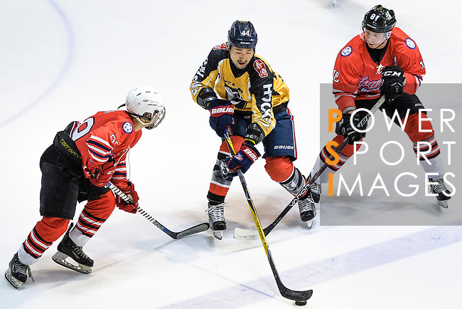 Shun Sakata of Empire Skate (C) fights for the puck with Jack Woods of Kowloon Generals (R) during the Mega Ice Hockey 5s match between Kowloon Generals and Empire Skate on May 02, 2018 in Hong Kong, Hong Kong. Photo by Marcio Rodrigo Machado / Power Sport Images