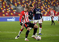 9th January 2021; Brentford Community Stadium, London, England; English FA Cup Football, Brentford FC versus Middlesbrough; Marcus Forss of Brentford being marked by Nathan Wood of Middlesbrough