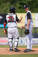 Catcher Matt Inouye (20) of the Kannapolis Intimidators has a chat with Starting pitcher Nathan Jones (26) at Fieldcrest Cannon Stadium in Kannapolis, NC, Monday May 26, 2008.