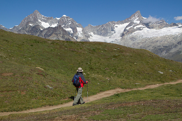 Woman hiking in the Alps above Zermatt, Switzerland. .  John leads hiking and photo tours throughout Colorado. .  John leads hikes and private photo tours in Boulder and throughout Colorado. Year-round.