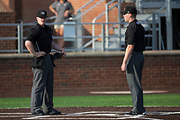 Home plate umpire Thomas Roche (left) and base umpire Andy Stukel meet at home plate prior to the Carolina League game between the Wilmington Blue Rocks and the Buies Creek Astros at Jim Perry Stadium on April 29, 2017 in Buies Creek, North Carolina.  The Astros defeated the Blue Rocks 3-0.  (Brian Westerholt/Four Seam Images)