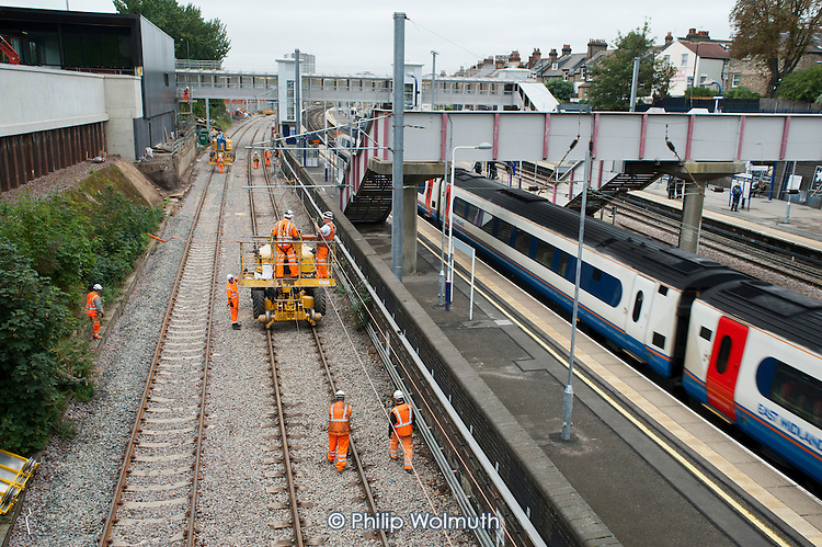 Railway construction workers working on the Thameslink Upgrade programme at West Hampstead Thameslink station, London.