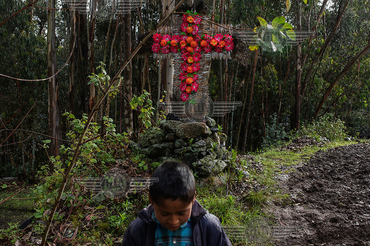 A cross made by peasants (campesinos) to protect the land, in the community of Llupa.