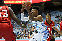 CHAPEL HILL, NC - NOVEMBER 01: Christian Keeling #55 of the University of North Carolina grabs a rebound during a game between Winston-Salem State University and University of North Carolina at Dean E. Smith Center on November 01, 2019 in Chapel Hill, North Carolina.