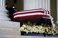 A Supreme Court Honor Guard salutes before moving the flag-draped casket of Justice Ruth Bader Ginsburg back into the court as Ginsburg lies in repose under the Portico at the top of the front steps of the U.S. Supreme Court building on Thursday, Sept. 24 2020, in Washington. Ginsburg, 87, died of cancer on Sept. 18. <br /> Credit: Andrew Harnik / Pool via CNP /MediaPunch<br /> CAP/MPI/RS<br /> ©RS/MPI/Capital Pictures