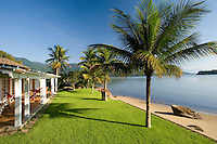 Private home in Parati Brazil. Casarao Amarilo is one of the most beautiful houses in Paraty town, only minutes walk from the historical centre. Veiw of the main house, the graden and private beach.
