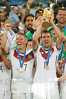 Miroslav Klose of Germany lifts the World Cup trophy after winning the 2014 final with Bastian Schweinsteiger