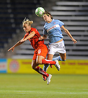 # 8 Megan Rapinoe of the Chicago Red Stars battles for the ball against #6 Lori Lohman of the Washington Freedom. The Red Stars won the game 2-1