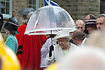 Merthyr Tydfil - UK - 26th April 2012 : The Queen with a brolly during a  visit to Cyfarthfa Castle museum and art gallery in Merthyr Tydfil this afternoon.  The Queen and Prince Philip are visiting towns and cities all over the United Kingdom to mark the Diamond Jubilee year.