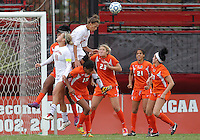 COLLEGE PARK, MD - OCTOBER 28, 2012:  Sarah Fichtner (25) of the University of Maryland leaps high over Ali Brennan (23) of Miami during an ACC  women's tournament 1st. round match at Ludwig Field in College Park, MD. on October 28. Maryland won 2-1 on a golden goal in extra time.