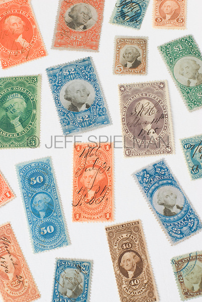 AVAILABLE FOR COMMERCIAL OR EDITORIAL LICENSING FROM GETTY IMAGES.  Please go to www.gettyimages.com and search for image # 173083834.<br /> <br /> Antique United States Revenue Stamps (Tax Stamps) issued by the U.S. government between the years 1862 and 1872.  These stamps, featuring a portrait of President George Washington, were used on documents and other paper items during the Civil War and in the following decade to show proof of payment of federal taxes.