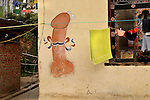 A painting of Phallus on a wall of a residential house. These Paintings are very frequently seen in Western Bhutan. These paintings are made to restrain any kind evil to the household. Arindam Mukherjee..