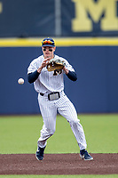 Michigan Wolverines shortstop Jack Blomgren (2) fields a ground ball against the Rutgers Scarlet Knights on April 27, 2019 in the NCAA baseball game at Ray Fisher Stadium in Ann Arbor, Michigan. Michigan defeated Rutgers 10-1. (Andrew Woolley/Four Seam Images)