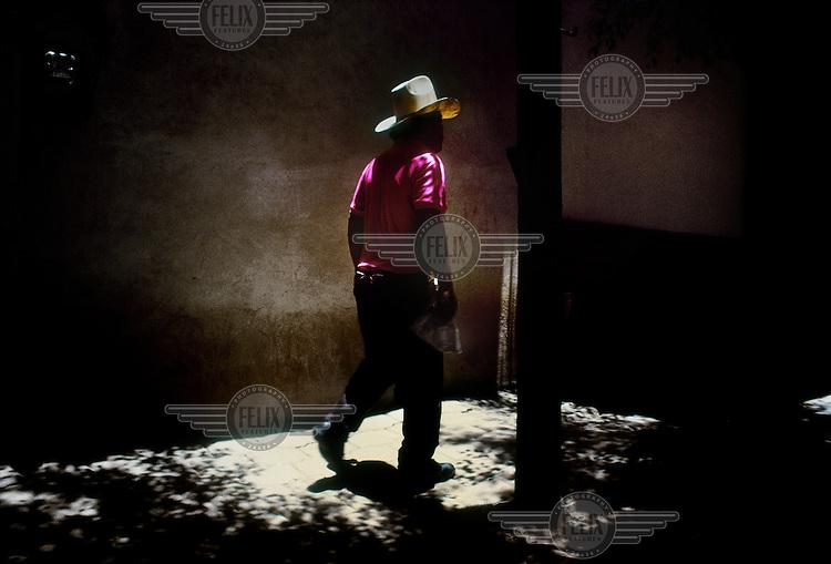 A man walking on a street in Huehuetenango.