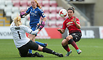 Goalkeeper Hannah Reid of Durham saves from Jess Sigsworth of Manchester United Women