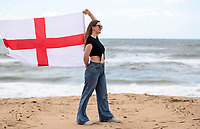 BNPS.co.uk (01202) 558833. <br /> Pic: CorinMesser/BNPS<br /> <br /> Pictured: Mya Punter-Bradshaw, 21, flying the flag for England. <br /> <br /> England fans visiting the beaches of Bournemouth, Dorset show their support for the team ahead of the Euro 2020 semi-final against Denmark Tomorrow (Wed).
