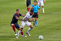 CHICAGO, UNITED STATES - AUGUST 25: Francisco Calvo #5 of Chicago Fire battles with Jurgen Locadia #10 of FC Cincinnati for the ball during a game between FC Cincinnati and Chicago Fire at Soldier Field on August 25, 2020 in Chicago, Illinois.
