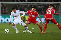 SWANSEA, WALES - MARCH 16: L-R Kyle Naughton of Swansea is closely marked by Philippe Coutinho during the Premier League match between Swansea City and Liverpool at the Liberty Stadium on March 16, 2015 in Swansea, Wales