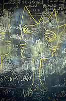 Drawings and scribbled notes on a blackboard by Jean Cocteau