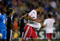 Thierry Henry (14) of the New York Red Bulls celebrates his goal by taking the ball out of the net during the game at RFK Stadium in Washington, DC.  D.C. United lost to the New York Red Bulls, 4-0.
