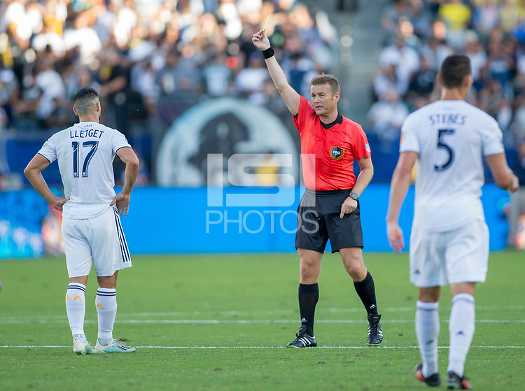 CARSON, CA - SEPTEMBER 29: Referee Alan Kelly presents Sebastian Lletget #17 of the Los Angeles Galaxy yellow during a game between Vancouver Whitecaps and Los Angeles Galaxy at Dignity Health Sports Park on September 29, 2019 in Carson, California.