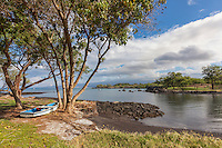 A boat lies ready near a small landing in a calm bay at Puako Bay, Big Island.