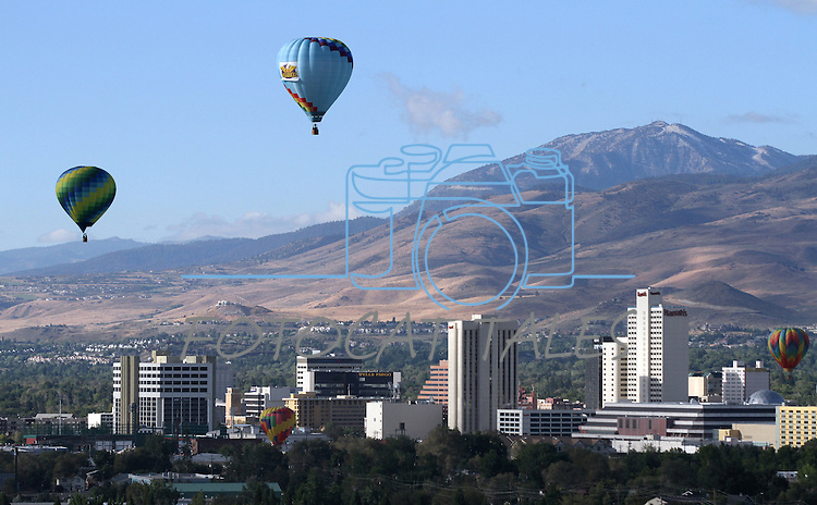Hot air balloons fly over downtown Reno, Nev. on media day of the Great Reno Balloon Race on Sept. 9, 2010..Photo by Cathleen Allison