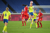 YOKOHAMA, JAPAN - AUGUST 6: Caroline Seger #17 of Sweden goes up for a header with Jessie Fleming #17 of Canada during a game between Canada and Sweden at International Stadium Yokohama on August 6, 2021 in Yokohama, Japan.