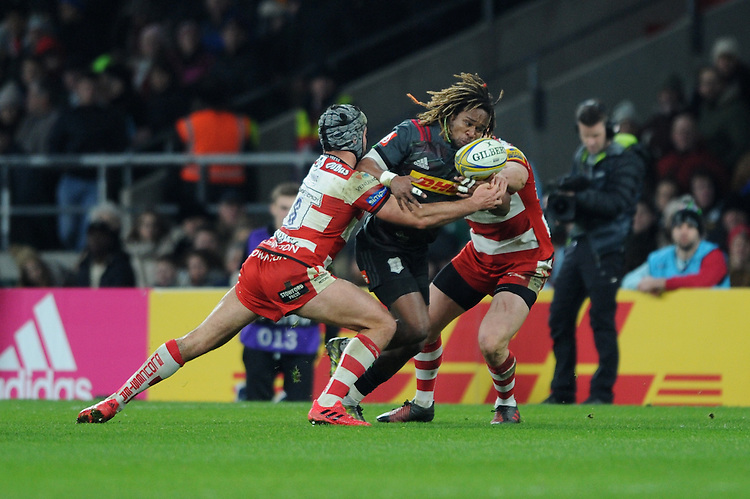 Marland Yarde of Harlequins is tackled by Gareth Evans of Gloucester Rugby during the Aviva Premiership Rugby match between Harlequins and Gloucester Rugby at Twickenham Stadium on Tuesday 27th December 2016 (Photo by Rob Munro/Stewart Communications)