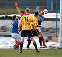 Cowdenbeath's Craig Moore (right) back heads the ball to score their first goal.