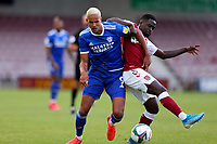 5th September 2020; PTS Academy Stadium, Northampton, East Midlands, England; English Football League Cup, Carabao Cup, Northampton Town versus Cardiff City; Robert Glatzel of Cardiff City competes for the ball with Christopher Missilou of Northampton Town