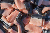 Pieces of whale blubber (muktuk) recently harvested from a Bowhead whale in the village of Kaktovik, Alaska, on Barter Island in the Beaufort Sea, Alaska.