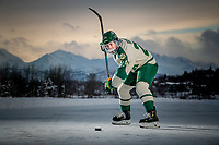 UAA Seawolves Hockey #24 forward Luc Brown on the ice at Anchorage's Westchester Lagoon.