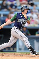 Lexington Legends catcher Mike Kvasnicka #7 swings at a pitch during a game against the Asheville Tourists at McCormick Field on May 7, 2012 in Asheville, North Carolina . The Tourists defeated the Legends 4-3. (Tony Farlow/Four Seam Images).