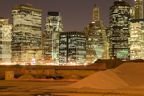 AVAILABLE FROM JEFF AS A FINE ART PRINT.<br /> <br /> AVAILABLE FROM GETTY IMAGES FOR COMMERCIAL AND EDITORIAL LICENSING.  Please go to www.gettyimages.com and search for image # 88696195.<br /> <br /> Lower Manhattan's Financial District Skyline Viewed from a Construction Site in Brooklyn at Night