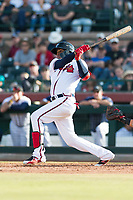 Peoria Javelinas center fielder Cristian Pache (27), of the Atlanta Braves organization, follows through on his swing during the Arizona Fall League Championship Game against the Salt River Rafters at Scottsdale Stadium on November 17, 2018 in Scottsdale, Arizona. Peoria defeated Salt River 3-2 in 10 innings. (Zachary Lucy/Four Seam Images)