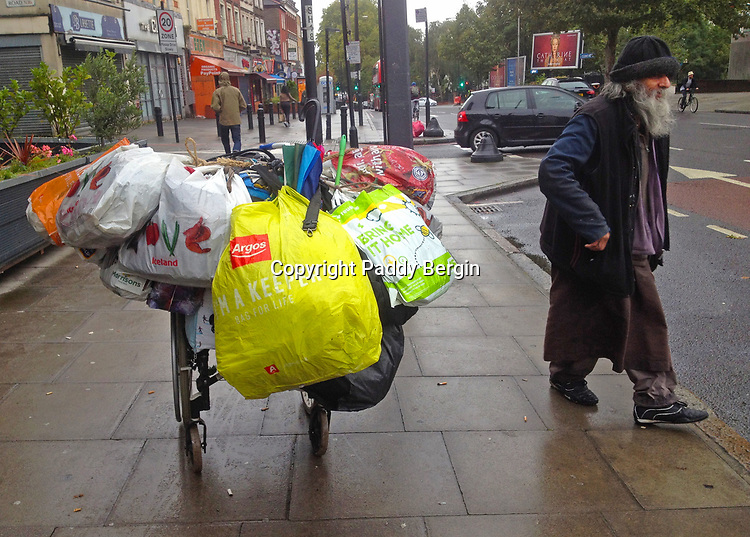 Bag Man in Stamford Hill, Stoke Newington, London N16.<br /> <br /> Trolley full of bags of stuff that he takes around with him.<br /> <br /> Stock Photo by Paddy Bergin