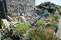Garden with old farm machinery, Rushen, Isle of Man.