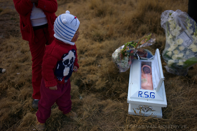 The funeral of Rosael Solis Gonzales takes place in the Quiulacocha cemetery, 2 km from Cerro de Pasco, Peru on Aug. 21, 2012. Rosael Solis Gonzalez was born dead on Aug. 17, 2012 to Nelly Gonzales Palacios, 31, who was eight months pregnant at the time. Nelly Gonzales Palacios's youngest son, Yover Solis Gonzales, 3, suffers from elevated levels of lead in his blood. The family lives in the Champamarca neighborhood which is surrounded on three sides by contaminated mine tailings.
