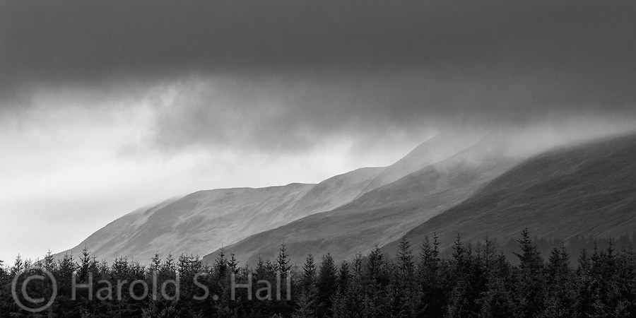 Driving along in Scotland on a typical cloudy and rain filled day, these varying shades of light and dark appealed to me.