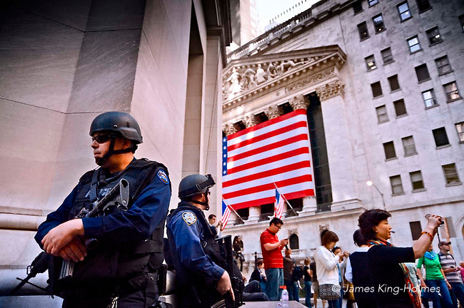 Armed NYPD police maintain guard at the New York Stock Exchange during the credit crunch financial crisis of 2008