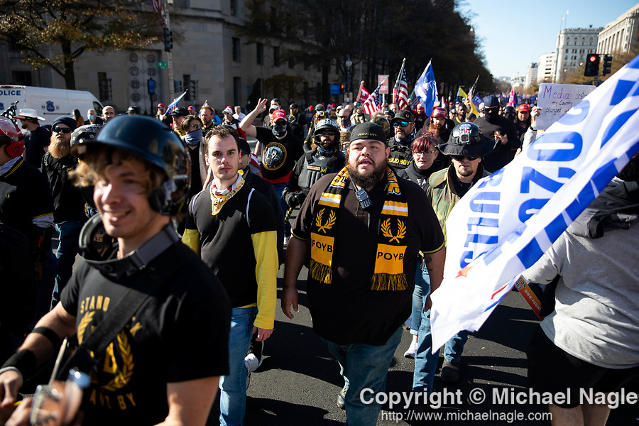 """The Proud Boys joined demonstrators protesting during the """"Million MAGA March"""" on November 14, 2020 in Washington, D.C.  Thousands of supporters of U.S. President Donald Trump gathered to protest the results of the 2020 presidential election won by President-Elect Joe Biden.  Photograph by Michael Nagle"""