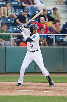 Wilton Martinez #11 of the Everett AquaSox at bat against the Vancouver Canadians at Everett Memorial Stadium in Everett, Washington on July 9, 2014.  Everett defeated Vancouver 9-4.  (Ronnie Allen/Four Seam Images)