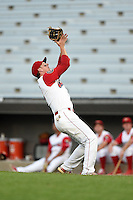 Williamsport Crosscutters first baseman Rhys Hoskins (12) catches a pop up during a game against the Aberdeen IronBirds on August 4, 2014 at Bowman Field in Williamsport, Pennsylvania.  Aberdeen defeated Williamsport 6-3.  (Mike Janes/Four Seam Images)