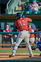Juan Carlos Negret (12) of the Idaho Falls Chukars at bat against the Ogden Raptors at Lindquist Field on August 9, 2019 in Ogden, Utah. The Raptors defeated the Chukars 8-3. (Stephen Smith/Four Seam Images)