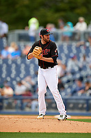 Nashville Sounds relief pitcher Chris Jensen (15) gets ready to deliver a pitch during a game against the New Orleans Baby Cakes on May 1, 2017 at First Tennessee Park in Nashville, Tennessee.  Nashville defeated New Orleans 6-4.  (Mike Janes/Four Seam Images)